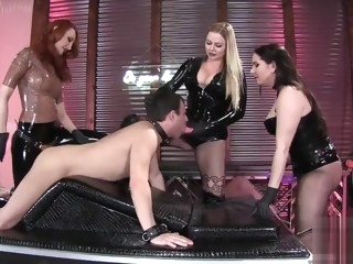 three latex mistresses fuck a slave gangbang red head